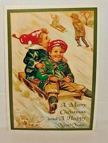 Christmas Kids Sledding Lillian Vernon Post Card Unused Children playing in snow