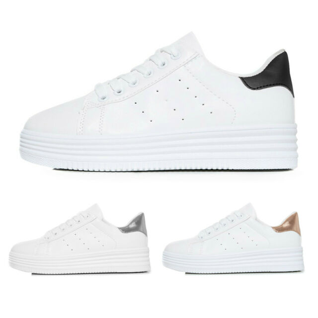 women's white and rose gold trainers