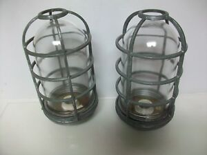 TWO NOS VINTAGE EXPLOSION PROOF CAGED LIGHT FIXTURE WITH GLASS
