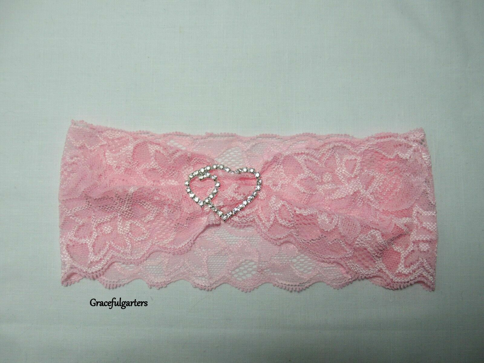 Baby Pink stretch lace garter with diamante heart buckle.Other colours available