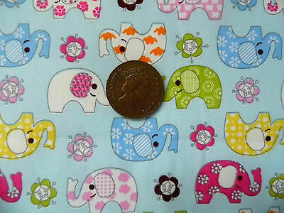 PATTERNED ELEPHANTS IN MULTICOLOURS ON BLUE - CHILDRENS 100% COTTON FABRIC F.Q.