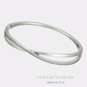 a30502bb3 Image is loading Authentic-Pandora-Silver-Entwined-Clear-CZ-Bangle-with-