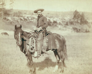 Cowboy-on-a-horse-poses-for-a-portrait-in-Sturgis-South-Dakota-1888-Photo-Print