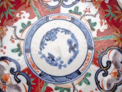 Assiette porcelaine polychrome Imari à décor floraux d'époque 19ème