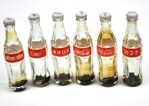 Set-mit-6-Coca-Cola-vintage-mini-Glas-Flaschen-8-cm-Internationale-Coke-Label