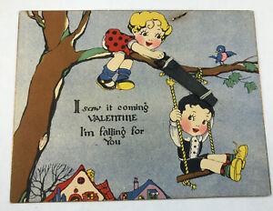 Vtg-Hallmark-Valentine-w-Metal-Saw-Attached-Boy-on-Swing-Girl-Sawing-Rope