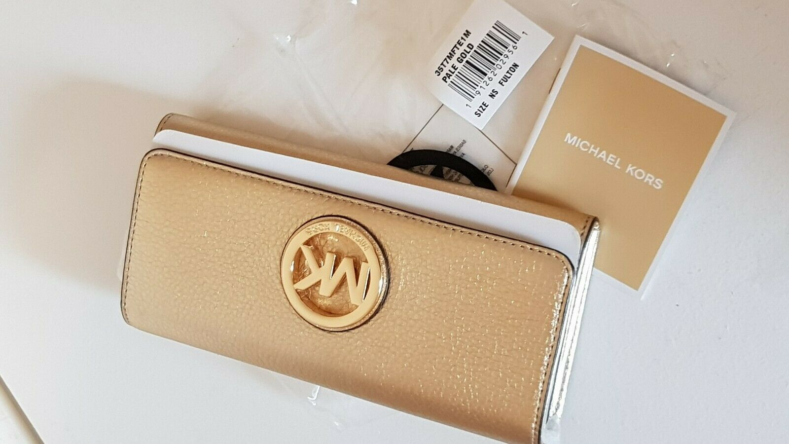 3af9f610d195 Michael Kors Fulton Pale Gold Leather Flap Clutch Purse Wallet for ...