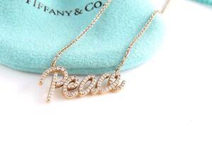 047cf0ac8 Tiffany & Co RARE 18K Rose Gold Picasso Peace Diamond Necklace | eBay