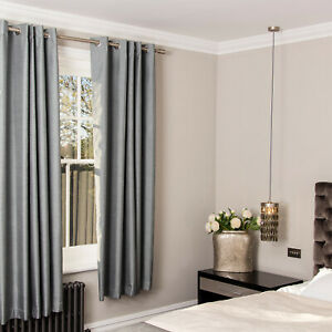 Pair-of-Silky-Effect-Blackout-Eyelet-Curtains-in-Silver-Blue-Colour