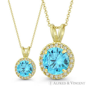 Faux-Blue-Topaz-amp-Clear-Round-Cut-CZ-Crystal-14mmx9mm-Pendant-in-14k-Yellow-Gold