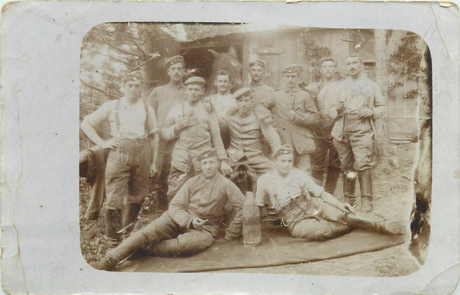 Military soldiers & horse stable early regimental real photo postcard