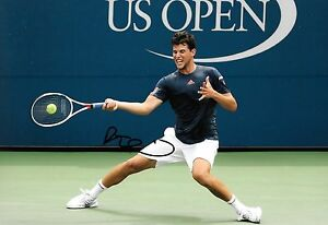 dominic thiem in action making a return shot signed 12x8 photo PROOF