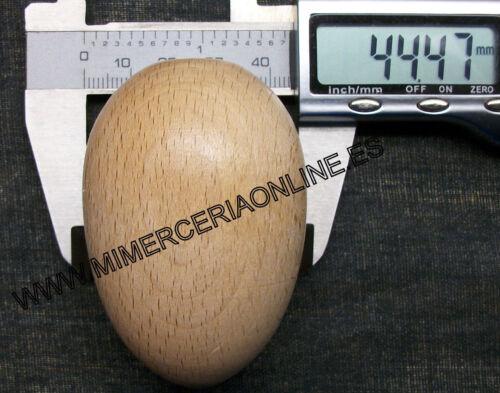 Huevo de madera para zurzir y labores de costura.