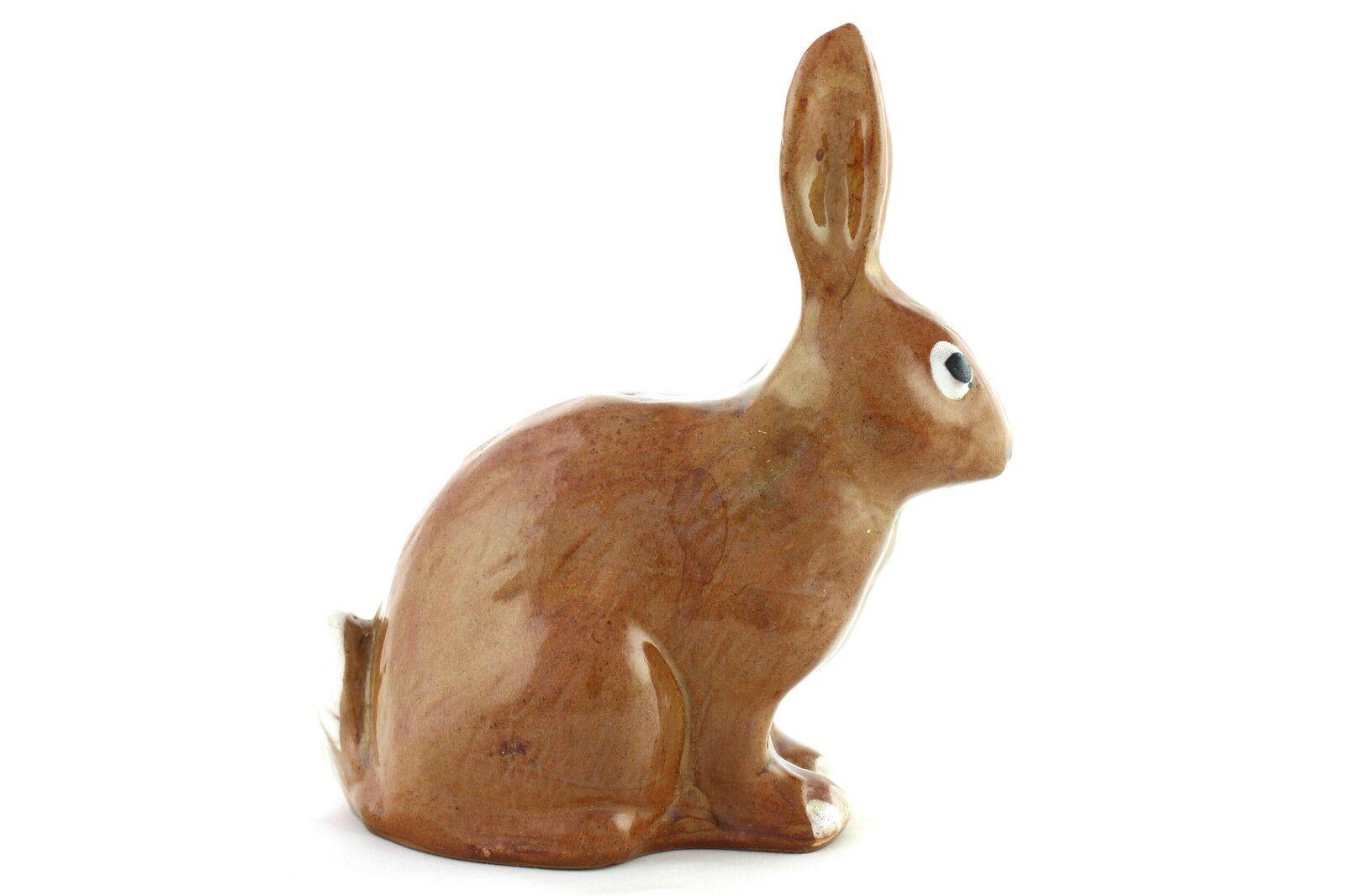 Una vintage marrone e bianco studio Pottery conigli. maiolica