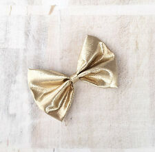 Cute gold lamé metallic hair bow