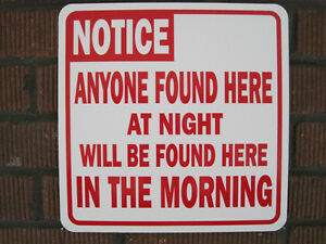 Sign: NOTICE: ANYONE FOUND HERE AT NIGHT WILL BE FOUND HERE IN THE MORNING