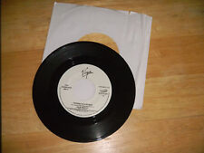 JUSTIN REEVES  trouble is a woman / he keeps me in one piece   virgin 45