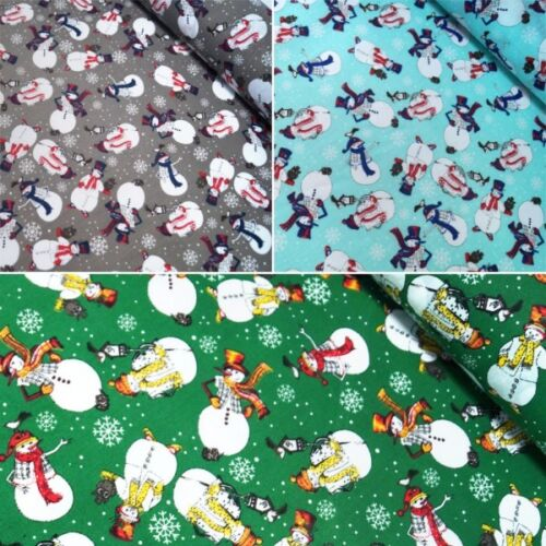 half metre of polycotton with fun penguins with red and green scarves on white
