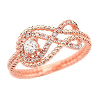 14k Rose Gold Infinity Beaded Ring With A 0.10 Ct Diamond & 32 Small Diamonds