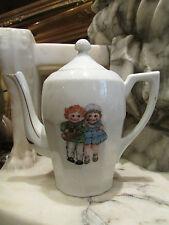 ancienne petite cafetiere en porcelaine decor enfants epoque 1925