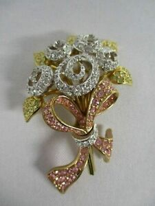 SIGNED  SWAROVSKI CRYSTAL BOUQUET OF FLOWERS PINK BOW COMPASSION BROOCH