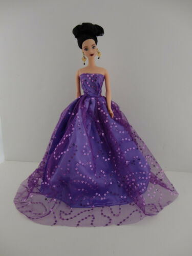 A Light Purple Ball Gown with Lots of Sparkle Made to Fit the Barbie Doll