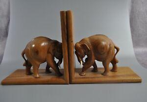 Vintage hand carved elephant book ends