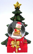 Small Snowman Wearing a Santa Hat LED Snowglobe with Christmas Tree Detail