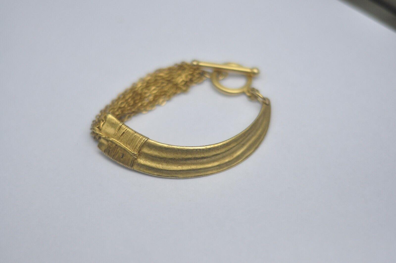 Elizabeth Cole gold horn and chain bracelet - image 1
