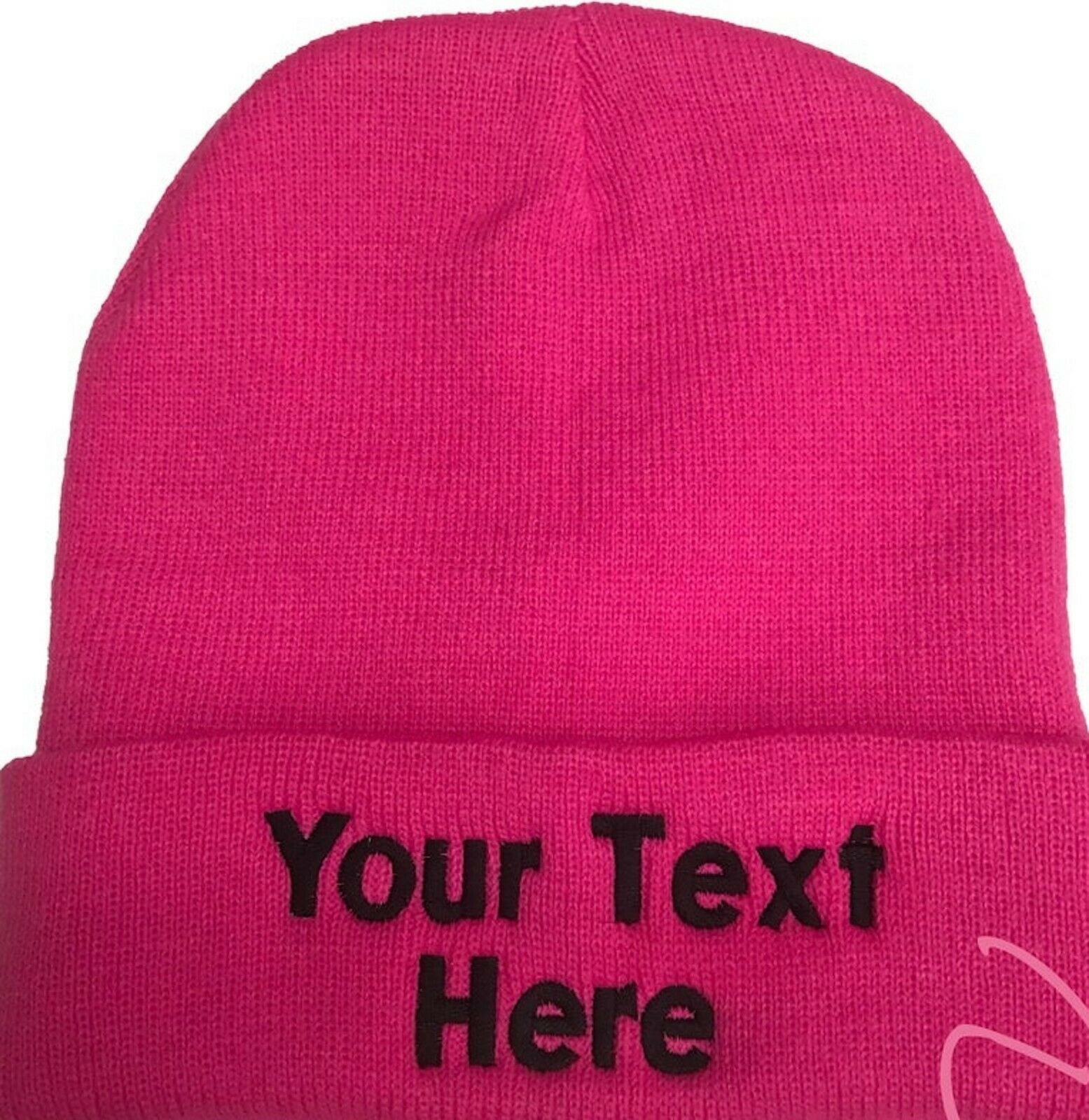 Neon pink custom embroidered beanie with the folded part