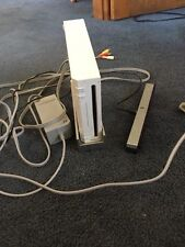 white wii, with games and two remotes, also things that you need for the games