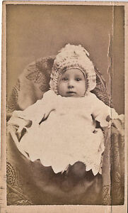 1870-1879-CDV-Baby-with-Elaborate-Ruffled-Ribbon-Bonnet-Edmore-MI-Howorth