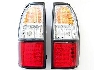 Toyota-Land-Cruiser-90-95-luces-de-senal-de-cola-trasero-02-Lampara-Cristal-Rojo-Blanco-LED