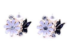 Gold tone enamel white daisy and black butterfly stud earrings