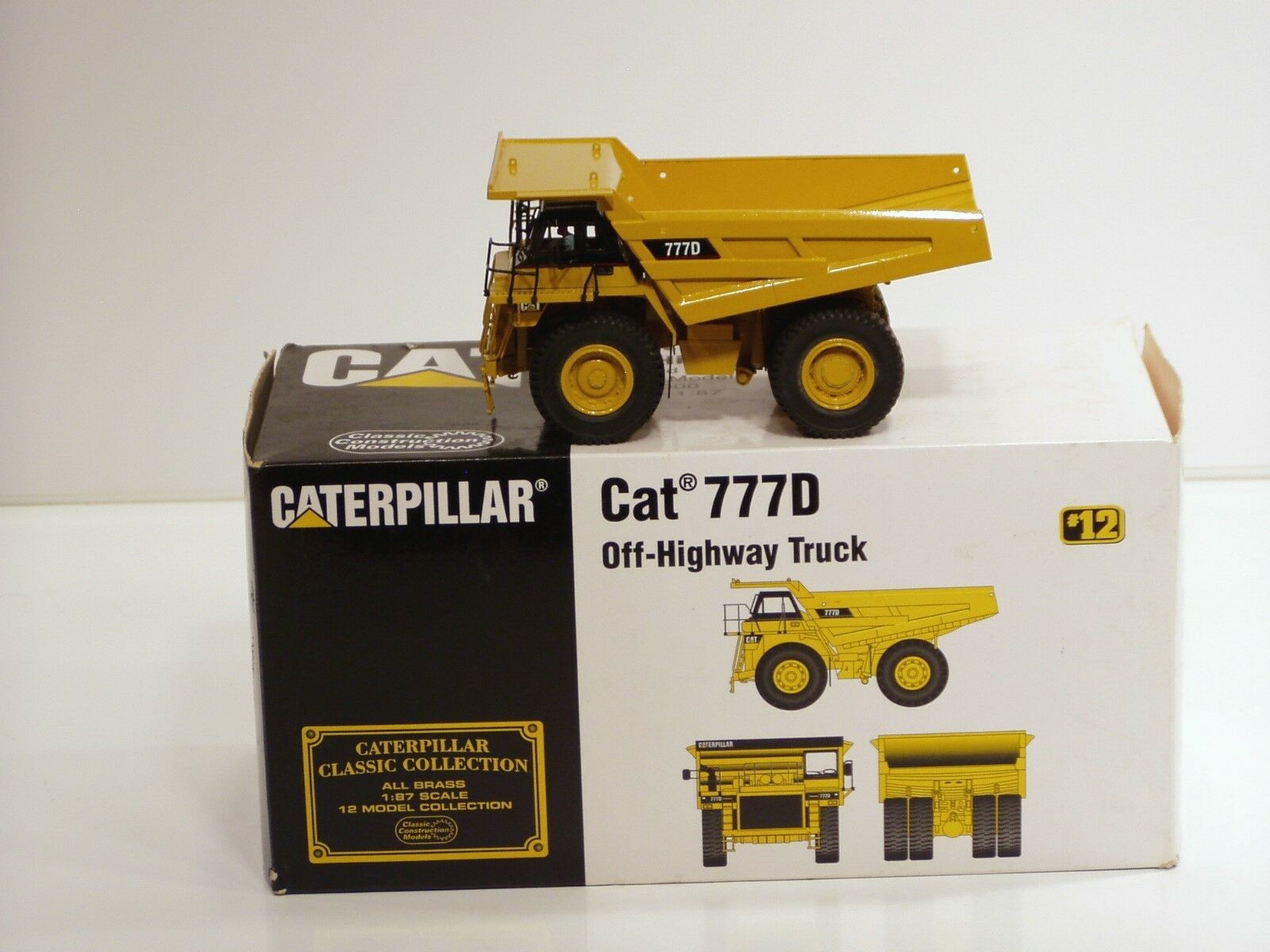 Caterpillar 777D Camion Benne - 1 87 - Laiton-CCM-N. Comme neuf IN BOX