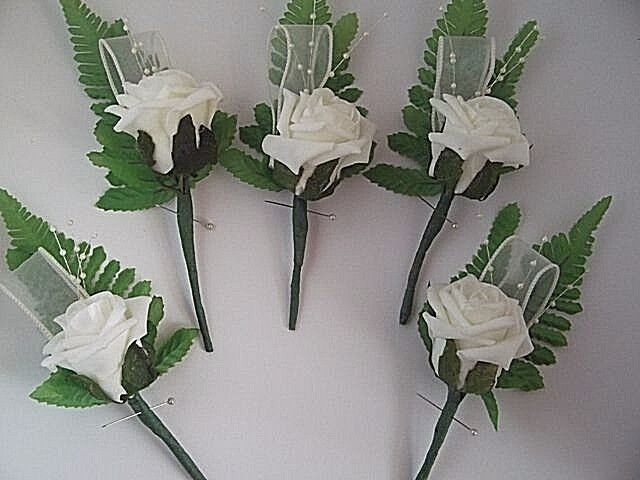 Wedding ivory rose buttonholes x 5 with ribbon diamantes and pearl sprays.