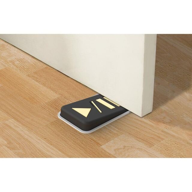 Door stopper shaped as a play/pause retro symbol Button symbols glow in the dark