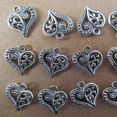 20pc Tibet silver hollow heart-shaped swing Charm Beads 14 * 15 mm PL027