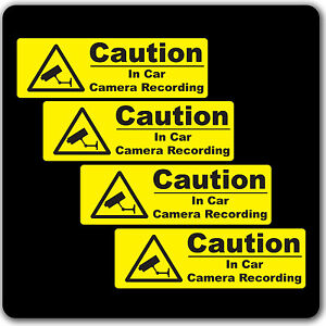 cctv yellow warning sticker signs in car camera recording taxi