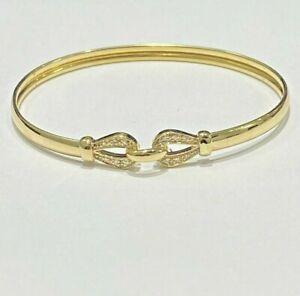 Bracelet jonc or 18 carat et 12 diamants