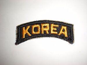 YELLOW ON BLACK ORIGINAL US ARMY KOREA TAB PATCH
