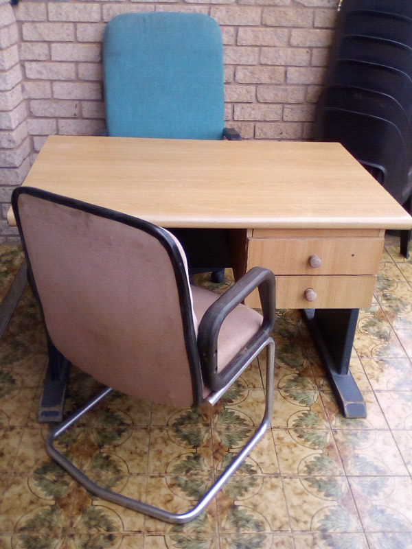 Office desk and two chairs