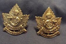 Two WW II/Pre WW II Canadian Collar Badge To The Saskatoon Light Infantry (M.G.)