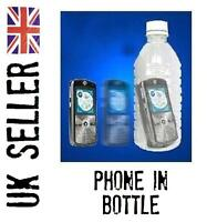 MOBILE PHONE IN BOTTLE. close up/street magic trick. illusion.
