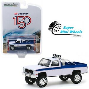 Greenlight-1-64-Anniversary-Series-1985-GMC-K-2500-BFGoodrich-150th-28020-B