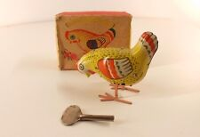 Oiseau russe URSS 464-БЛ tôle moteur clé Tin toy 7 cm mint in box