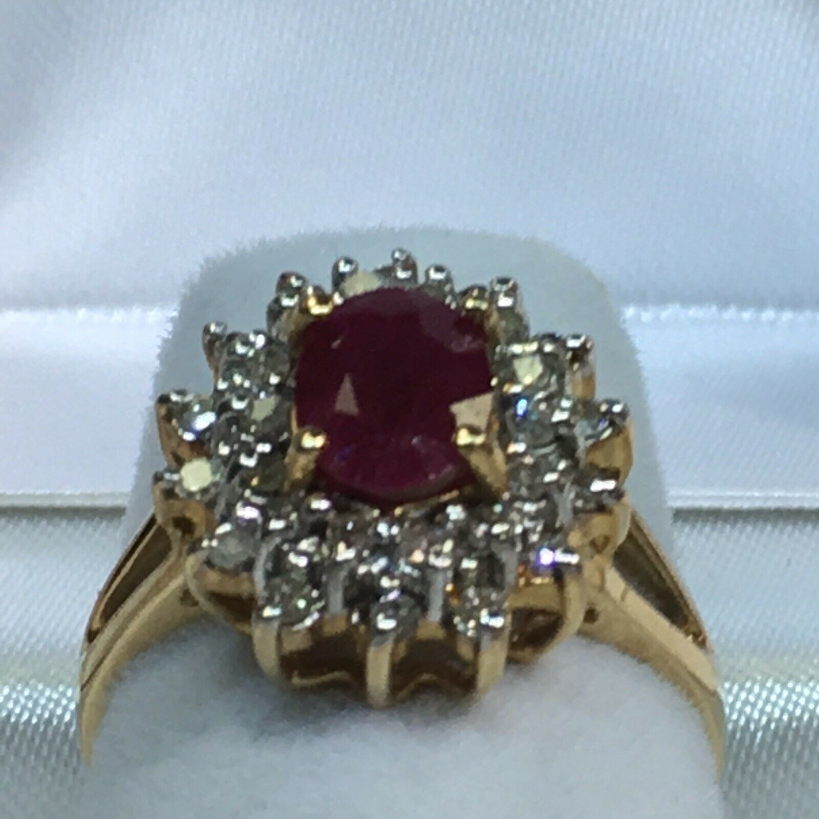 10k gold Ring With Oval Ruby And A Double Row Of Diamonds Around It