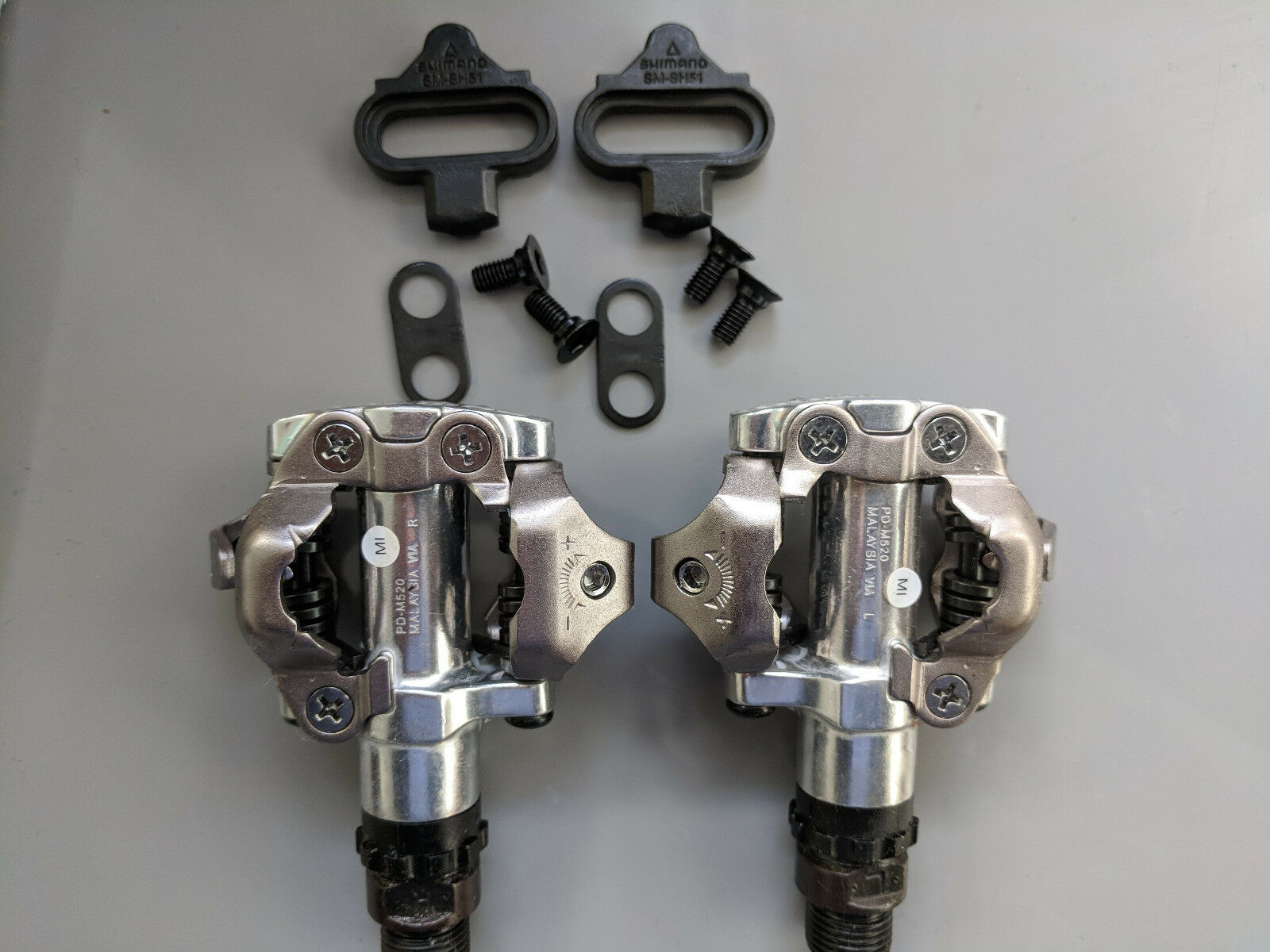 Shimano PD M520 SPD  Pedals + Cleats, new genuine Shimano Recorded delivery