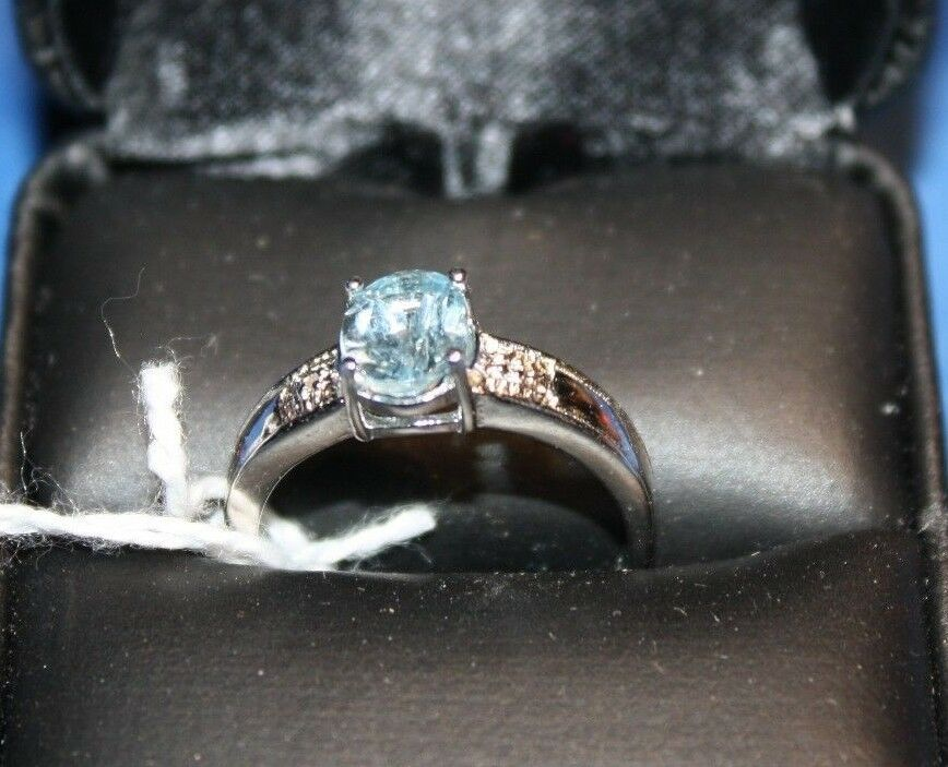 New Sky bluee topaz ring with diamond accents size 8