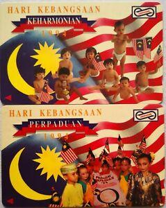 Malaysia Used Phone Cards - 2 pcs Hari Kebangsaan 1994